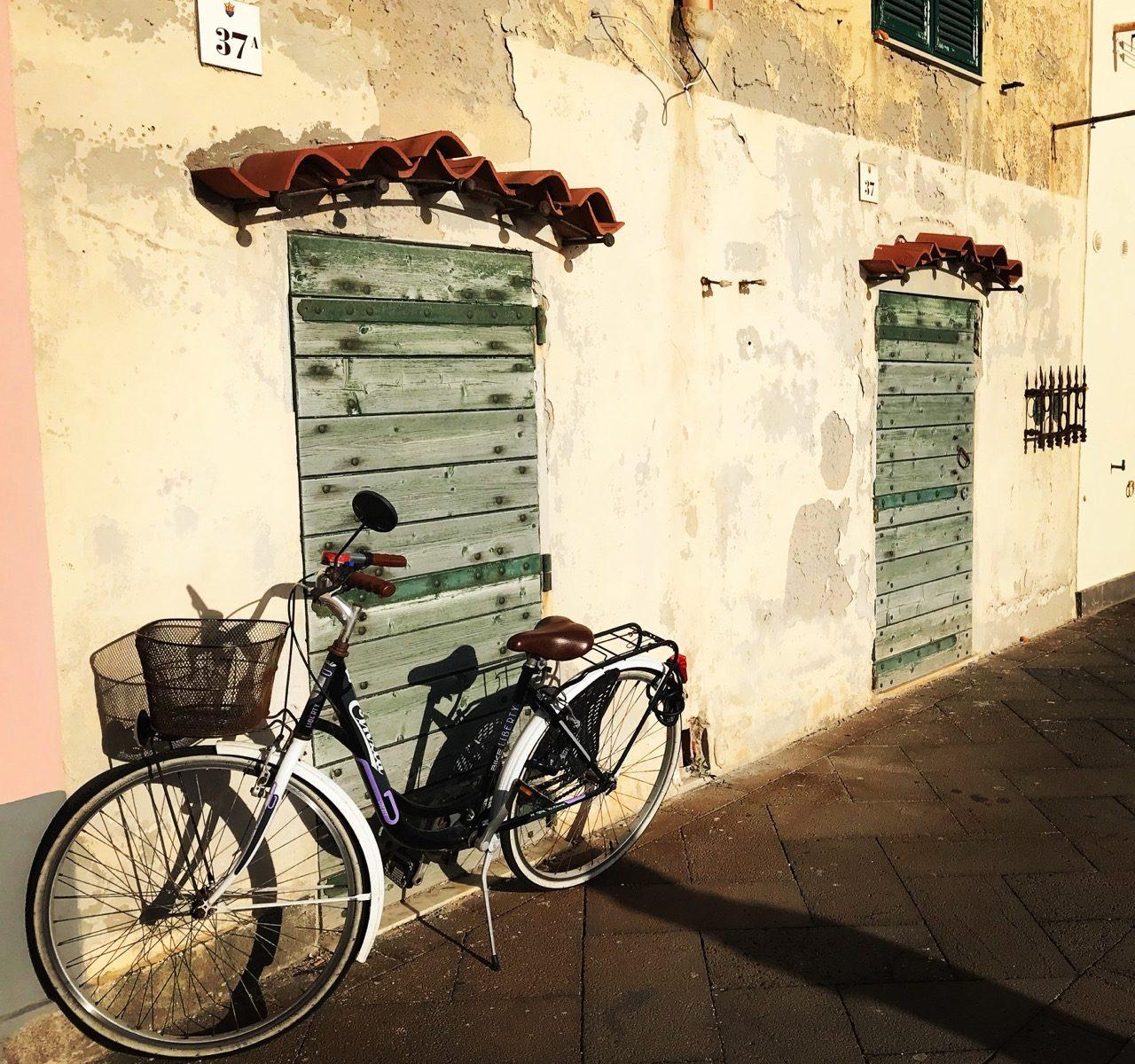 Bicycle in front of old door in Alghero